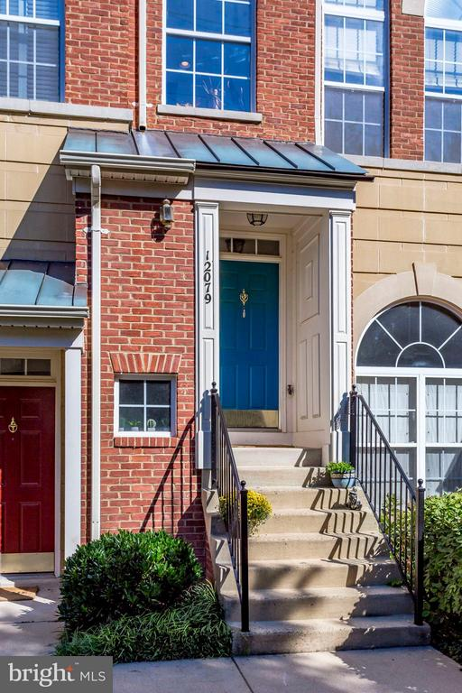 The front door of the unit - 12079 TRUMBULL WAY, RESTON