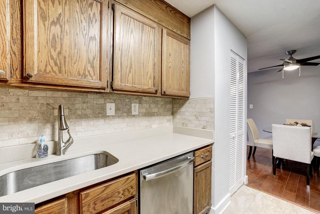 Kitchen pantry on the right! Rare find. - 4600 FOUR MILE RUN DR #303, ARLINGTON