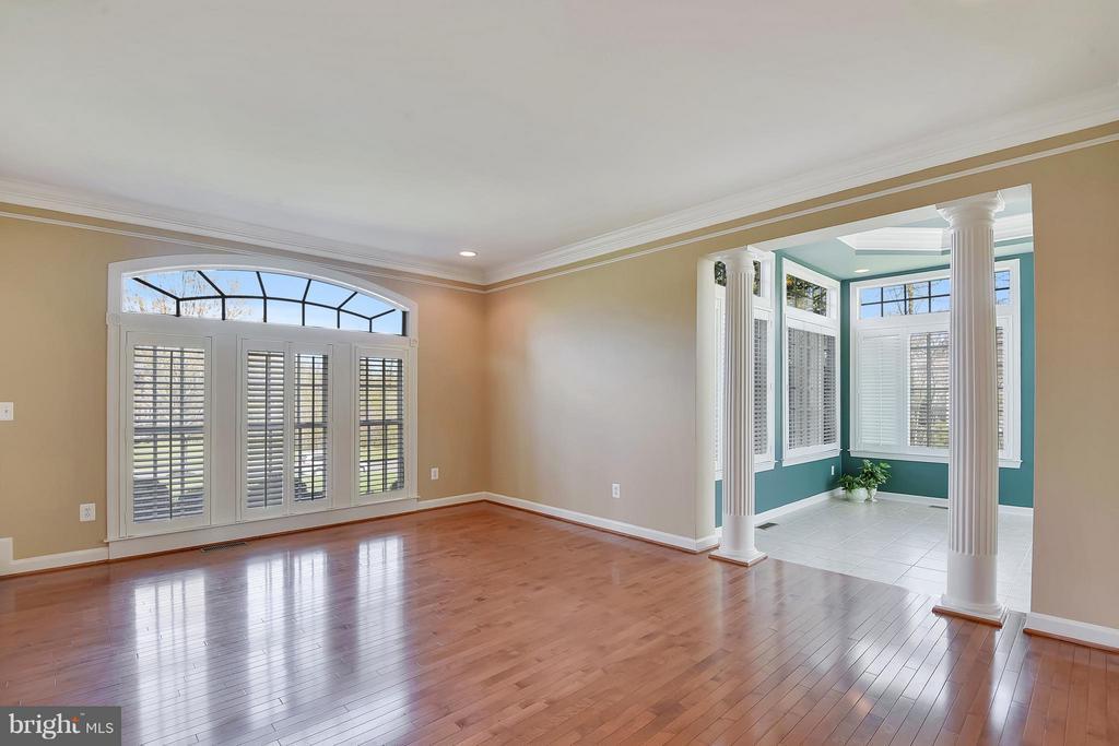 Gleaming Hardwood floors in a GenerousLLiving Room - 42739 CEDAR RIDGE BLVD, CHANTILLY