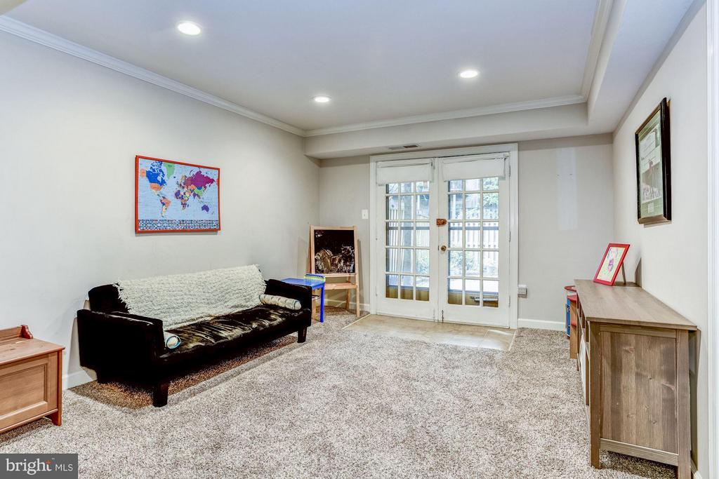 Basement with french doors leading to paver patio - 11715 N SHORE DR, RESTON