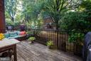 Spacious deck overlooking fenced in paver patio - 11715 NORTH SHORE DR, RESTON