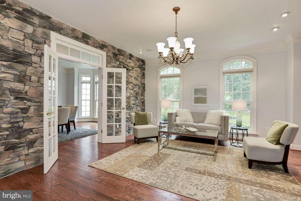 Living room with Stone Wall and French Doors - 1211 RESTON AVE, HERNDON