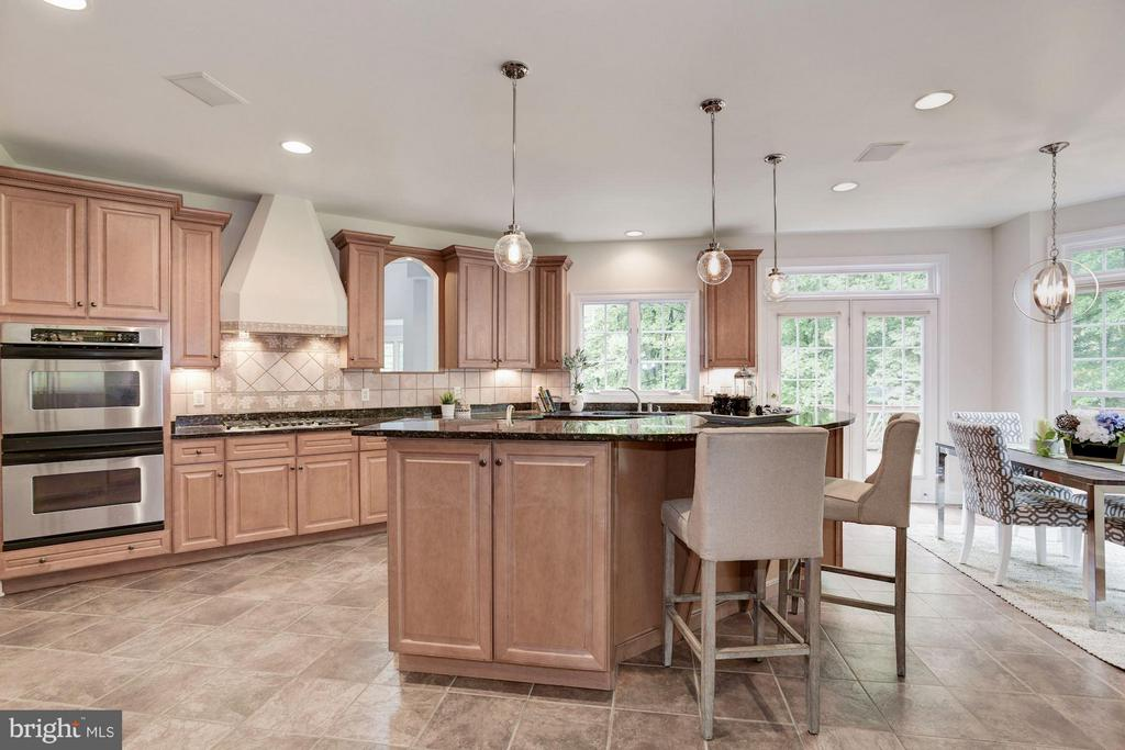 Kitchen w/Breakfast room & French Doors to deck. - 1211 RESTON AVE, HERNDON
