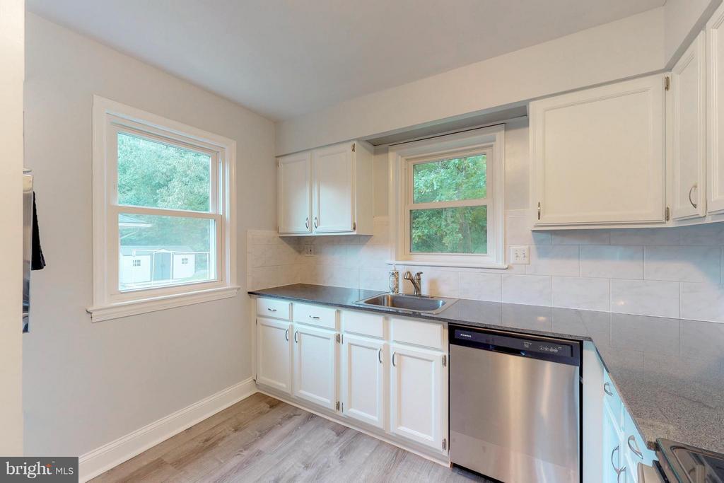 Kitchen with new laminate wood flooring - 3033 CRANE DR, FALLS CHURCH