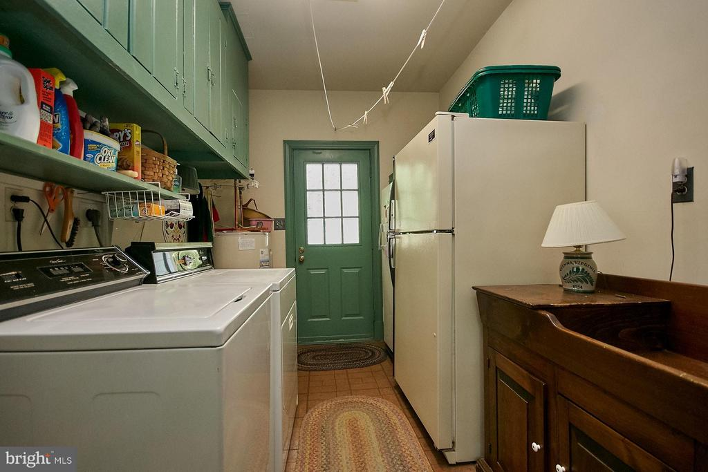 Laundry room with ample shelf/cabinet space - 10810 HUNTER STATION RD, VIENNA