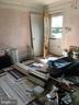 Living Room, extra supplies on floor - 6005 GRAYSON ST, SPRINGFIELD