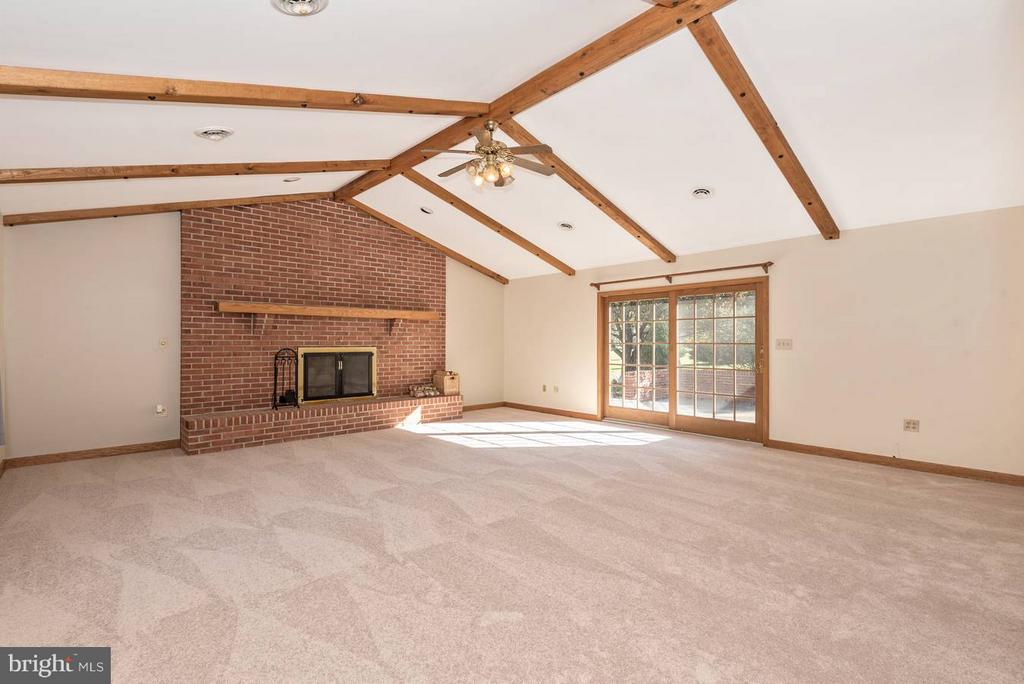 Family Room with all brick fireplace. - 12492 HOWARD LODGE DR, SYKESVILLE