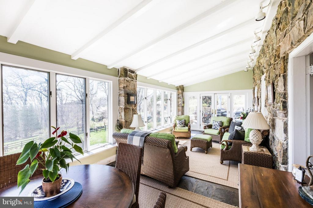 Amazing views from the sunroom with stone floors. - 18490 BLUERIDGE MOUNTAIN RD, BLUEMONT