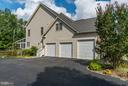 3 car garage with an oversized bay - 5874 IRON STONE CT, CENTREVILLE