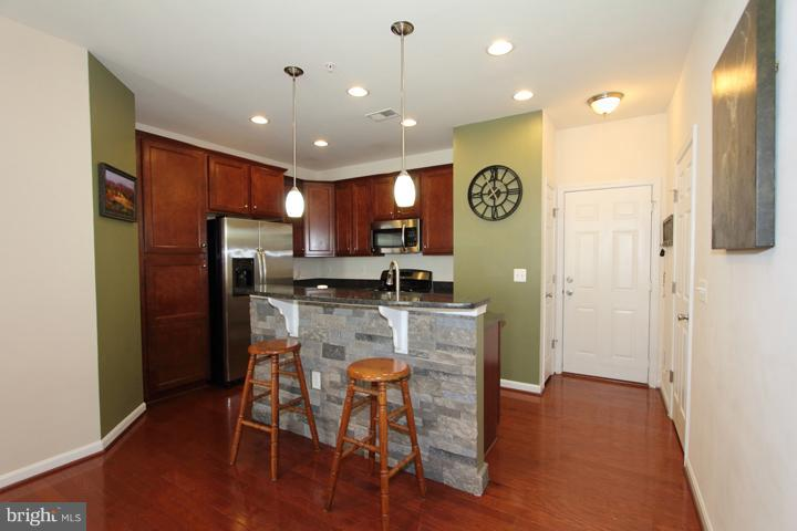 Kitchen with stone accented wall on island - 9551 SOUTH HALL TER, MANASSAS