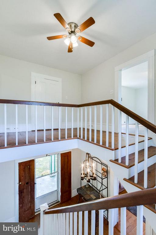 Gorgeous staircase w/ door outside balcony - 3667 WOLFTOWN HOOD RD, MADISON