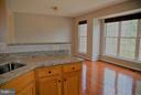 Kitchen looking into large eat in area - 24643 CLOCK TOWER SQ, ALDIE