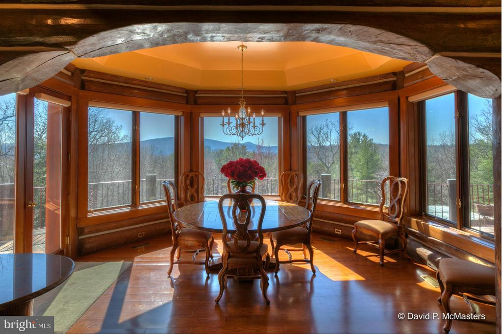 BREAKFAST AREA TO BIG DECK. GREAT VIEW. NOTE ARCH - 610 PIN OAK RD, PAW PAW