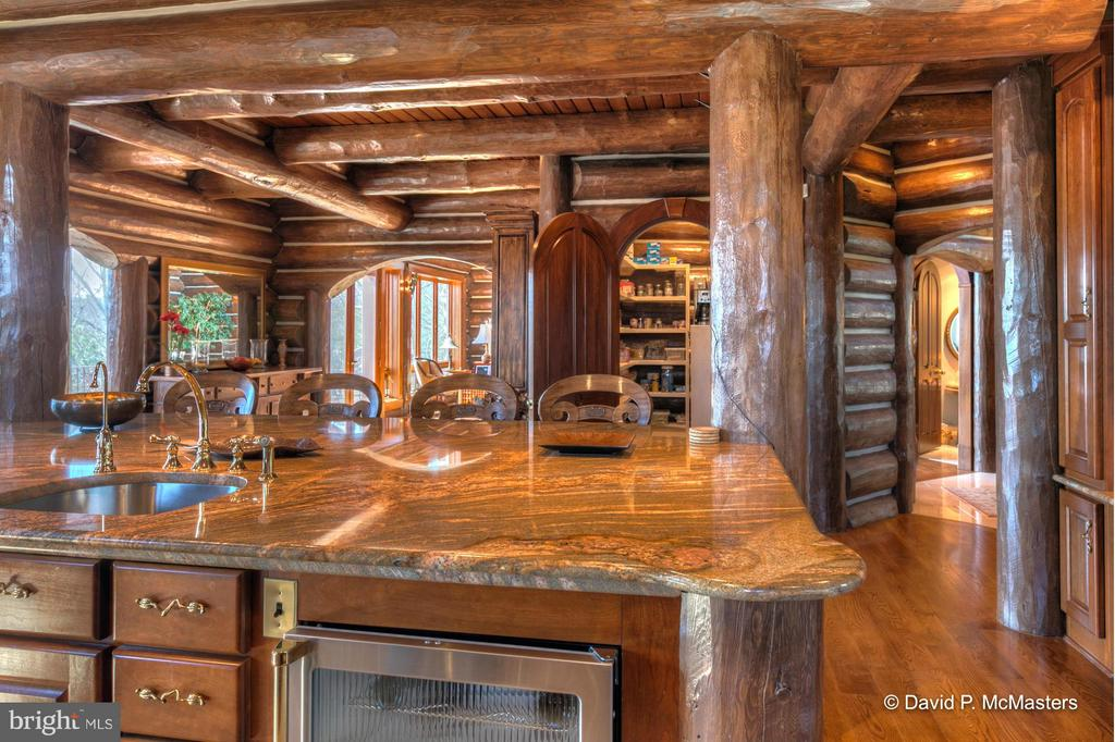 MARBLE KITCHEN ISLAND. NOTE 3 ARCHED DOORWAYS! - 610 PIN OAK RD, PAW PAW