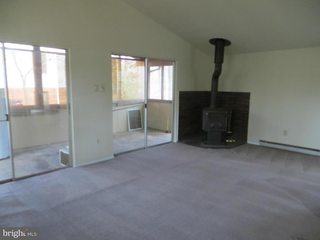 Living Room with woodstove - 413 WESTOVER PKWY, LOCUST GROVE
