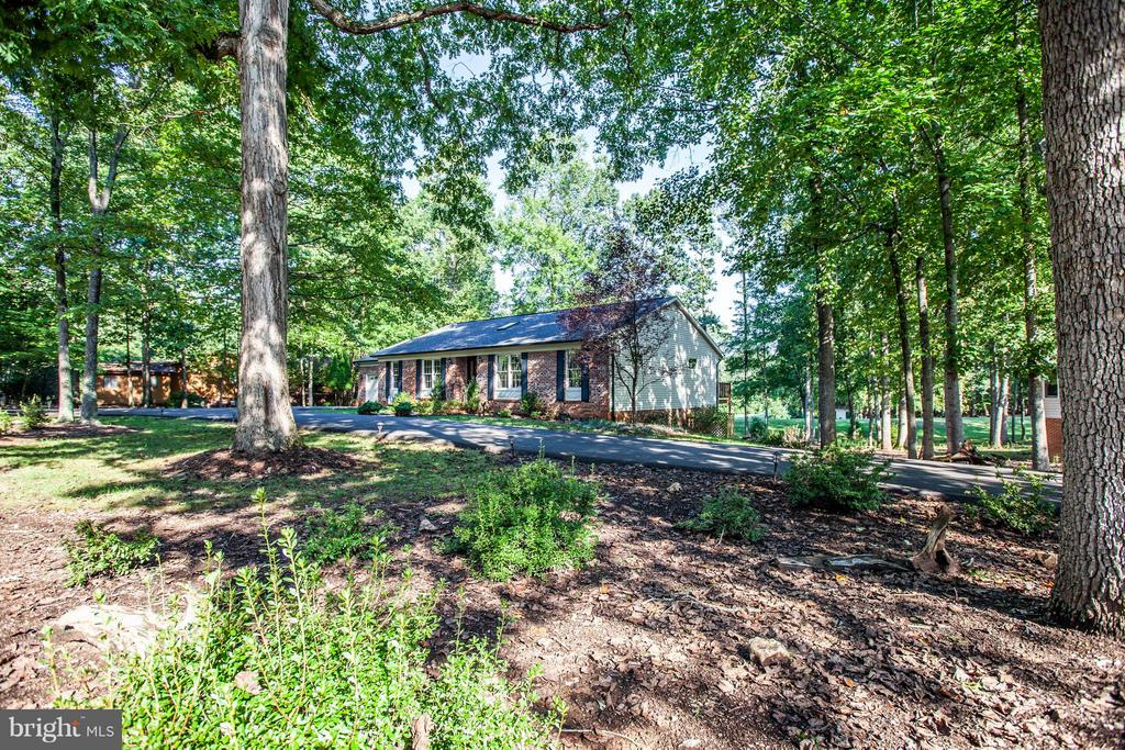 Tucked back in the trees. - 303 GOLD VALLEY RD, LOCUST GROVE