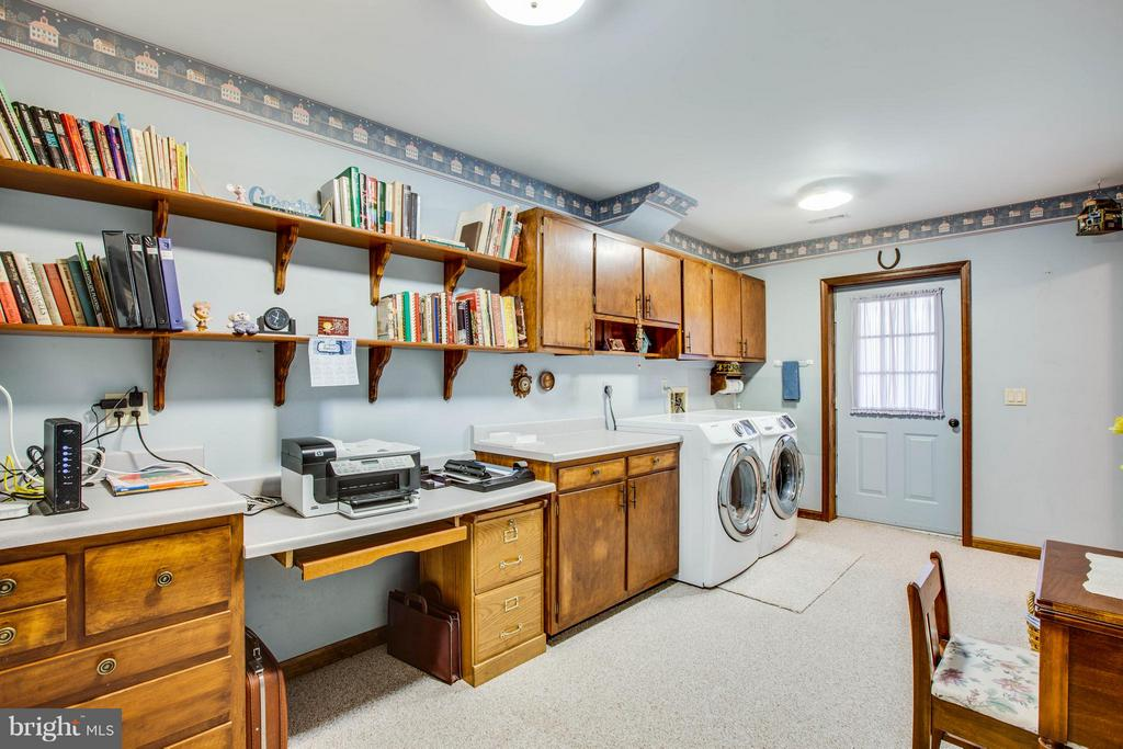 Super huge laundry can double as an office. - 303 GOLD VALLEY RD, LOCUST GROVE