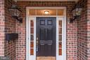 Front entryway featuring two gas lamps. - 1956 VERMONT ST N, ARLINGTON