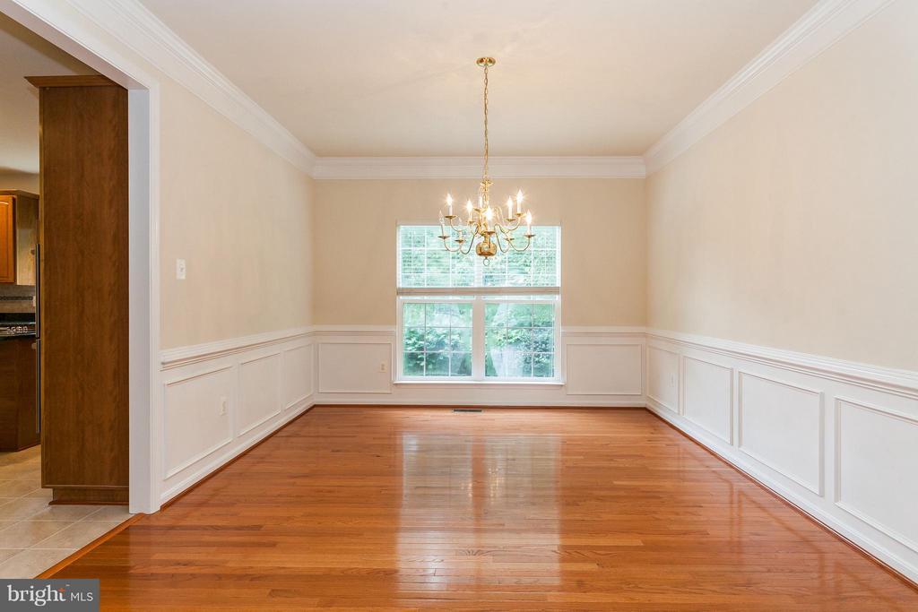 Dining Room w/New Wood Floors, Wainscotting, Crown - 9311 EAGLE CT, MANASSAS PARK