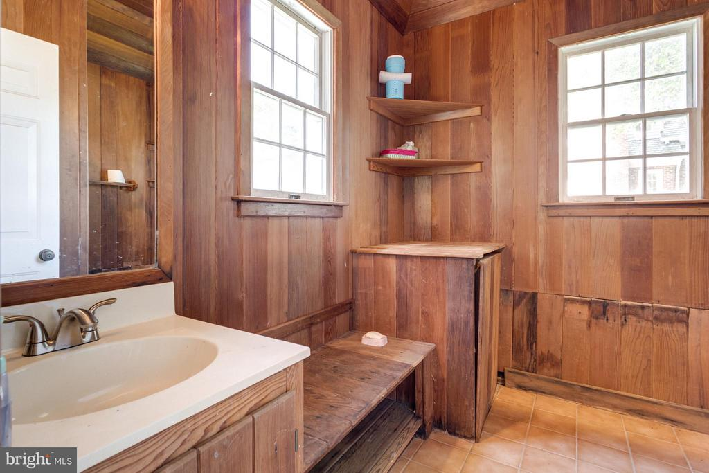 Wood-paneled pool house changing room - 10431 NEW ASCOT DR, GREAT FALLS
