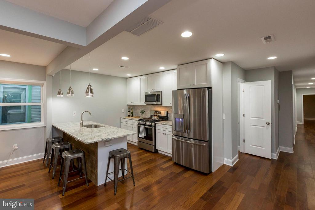 Kitchen w/smooth granite + premium appliances - 4479 C ST SE, WASHINGTON