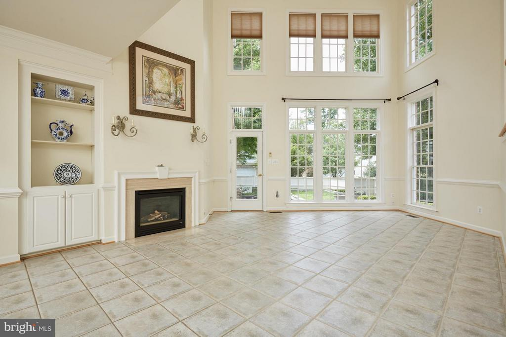 Two Story Family Room featuring Gas Fireplace - 3860 FARRCROFT DR, FAIRFAX