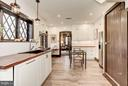 Kitchen - Access to rear staircase and powder room - 8110 GEORGETOWN PIKE, MCLEAN