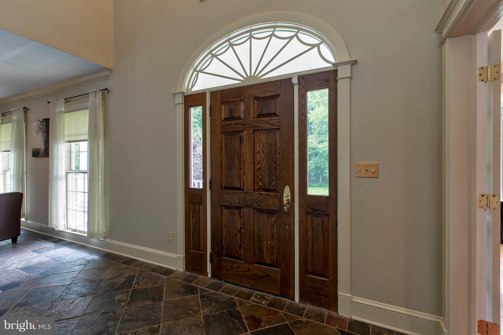 Solid Oak Door opens to a foyer - 16808 OAK HILL RD, SILVER SPRING