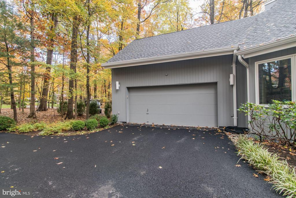 Two car garage with newly refinished flooring - 11903 TRIPLE CROWN RD, RESTON