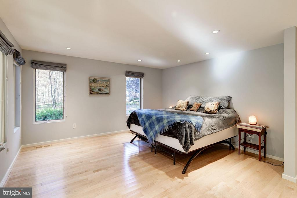 Blond maple hardwood flooring continues - 11903 TRIPLE CROWN RD, RESTON
