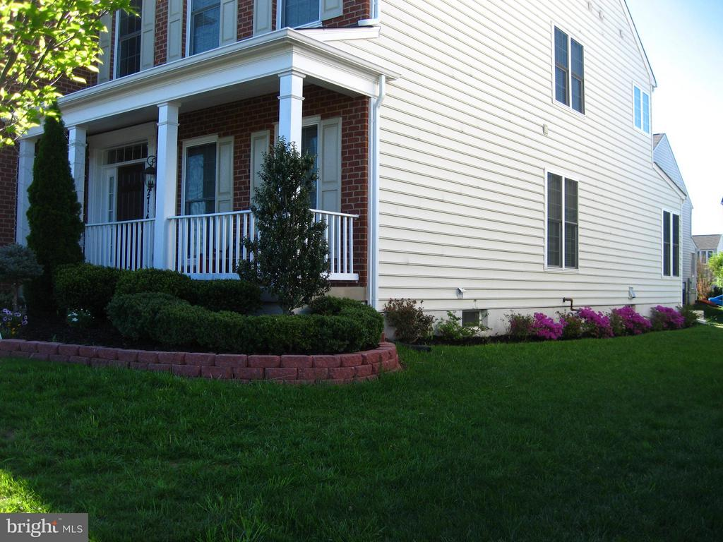 Lovely garden beds in full bloom. - 12714 W OLD BALTIMORE RD, BOYDS