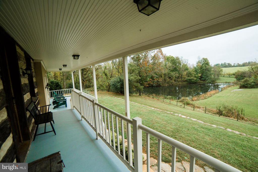 Porch overlooking pond - 19923 WOODTRAIL RD, ROUND HILL
