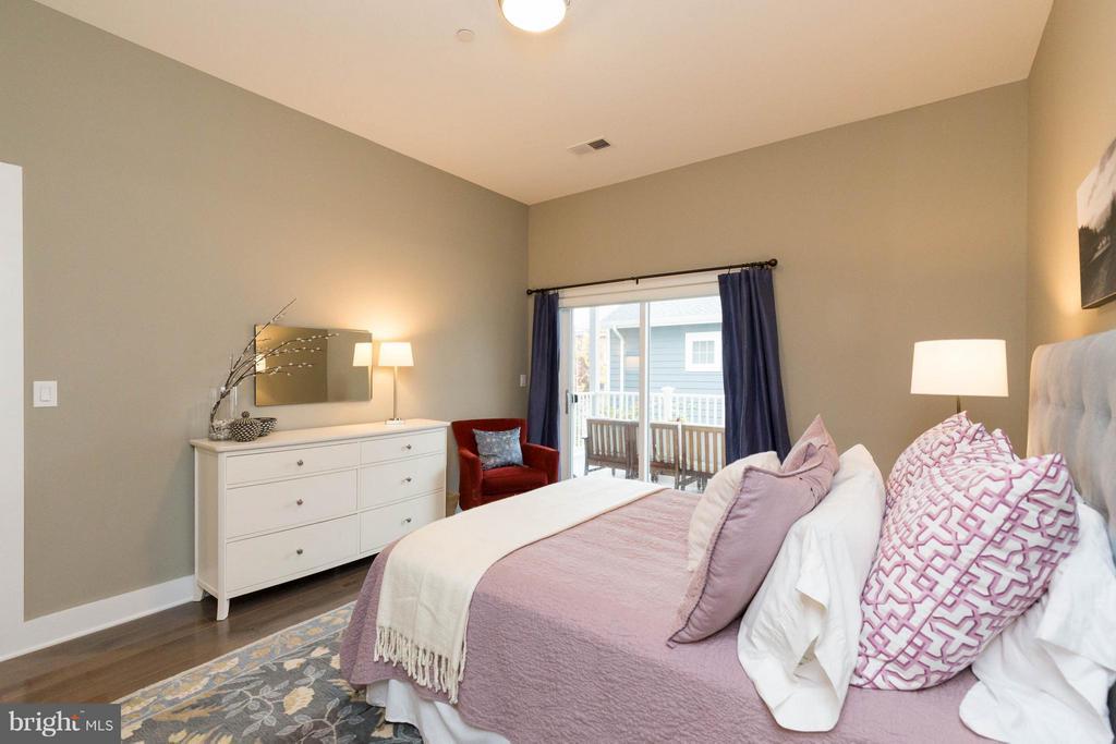 Master bedroom with sliders leading to balcony. - 630 14TH ST NE #3, WASHINGTON