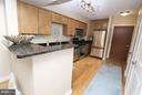 Kitchen features granite counters - 915 E ST NW #306, WASHINGTON