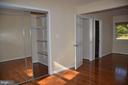Walk-in closet in master bedroom - 7412 BRADDOCK RD, ANNANDALE