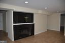 Family room in basement with fireplace - 7412 BRADDOCK RD, ANNANDALE