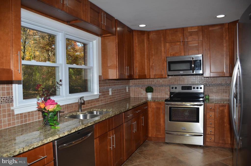 Kitchen with stainless steel appliances - 7412 BRADDOCK RD, ANNANDALE