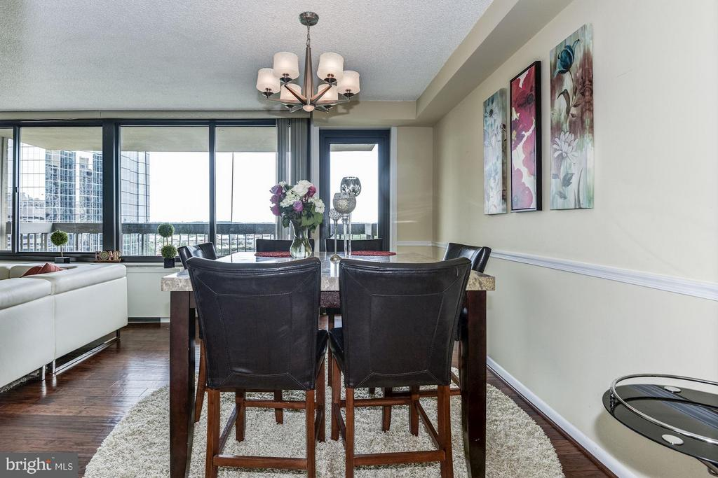 Hardwood floors,access to kitchen and balcony - 3701 GEORGE MASON DR #1406N, FALLS CHURCH