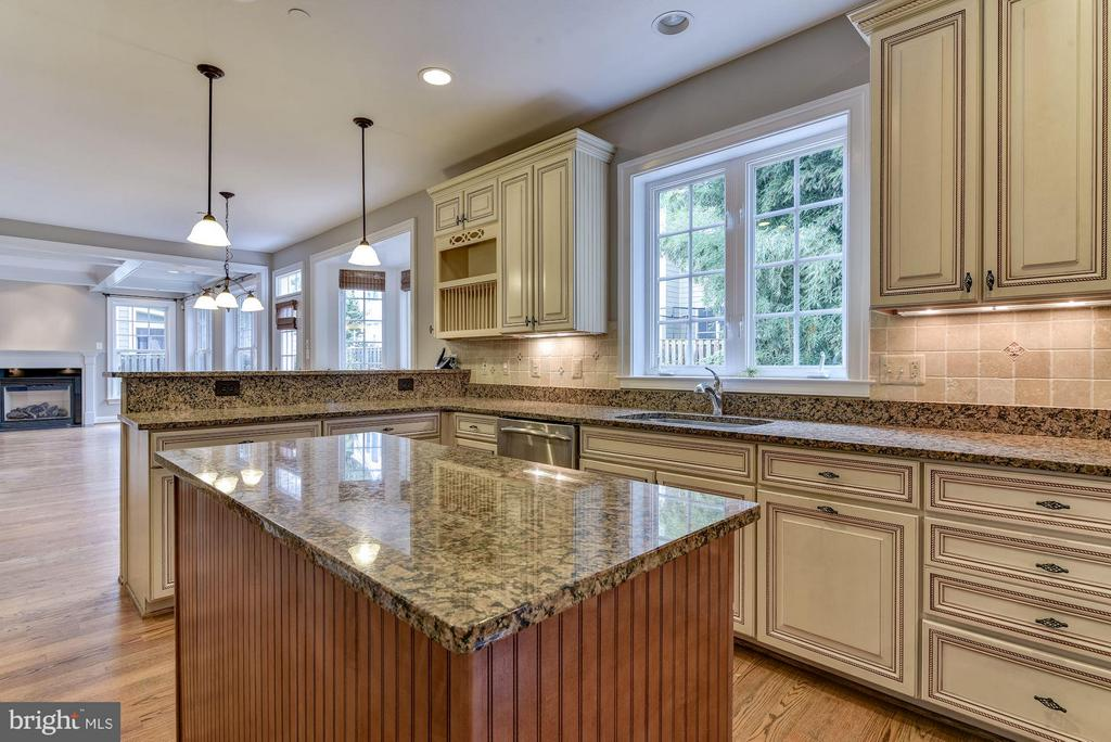Large family room with fireplace off kitchen. - 4516 WINDSOR LN, BETHESDA