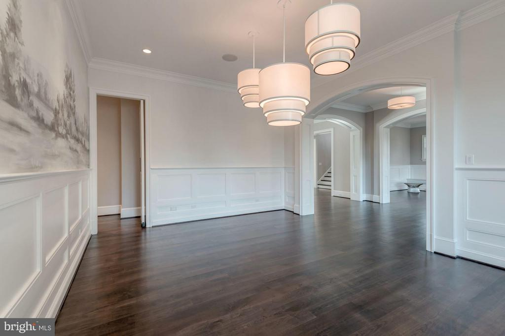Dining room with 3 lights and view of foyer - 10603 CREAMCUP LN, GREAT FALLS