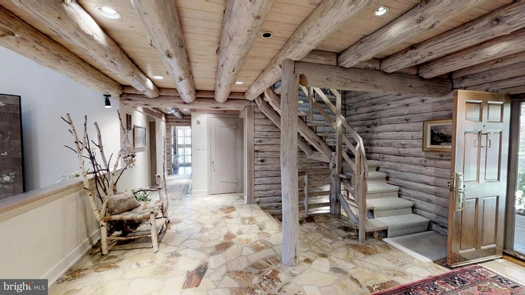Expansive foyer with stone floor and exposed beams - 11713 WAYNE LN, BUMPASS