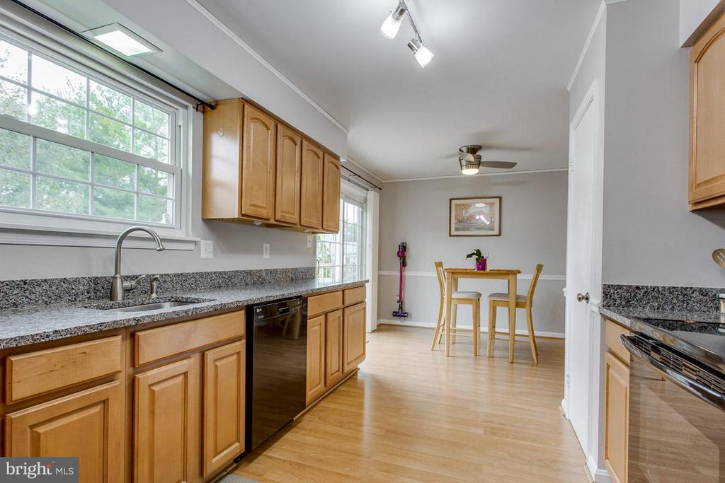 Kitchen has granite counters and harwood flooring - 4338 CUB RUN RD, CHANTILLY