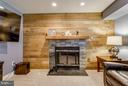 Reclaimed oak wood wall w/stone veneer fireplace - 4338 CUB RUN RD, CHANTILLY