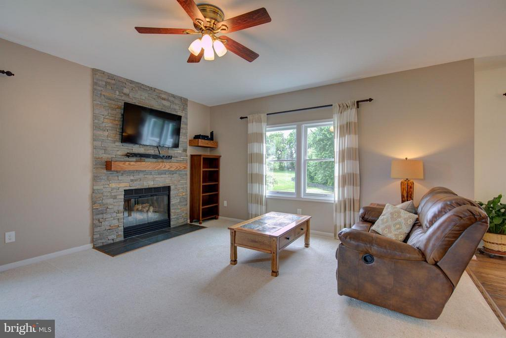 Family Room w/wood burning stone fireplace - 18990 LOUDOUN ORCHARD RD, LEESBURG