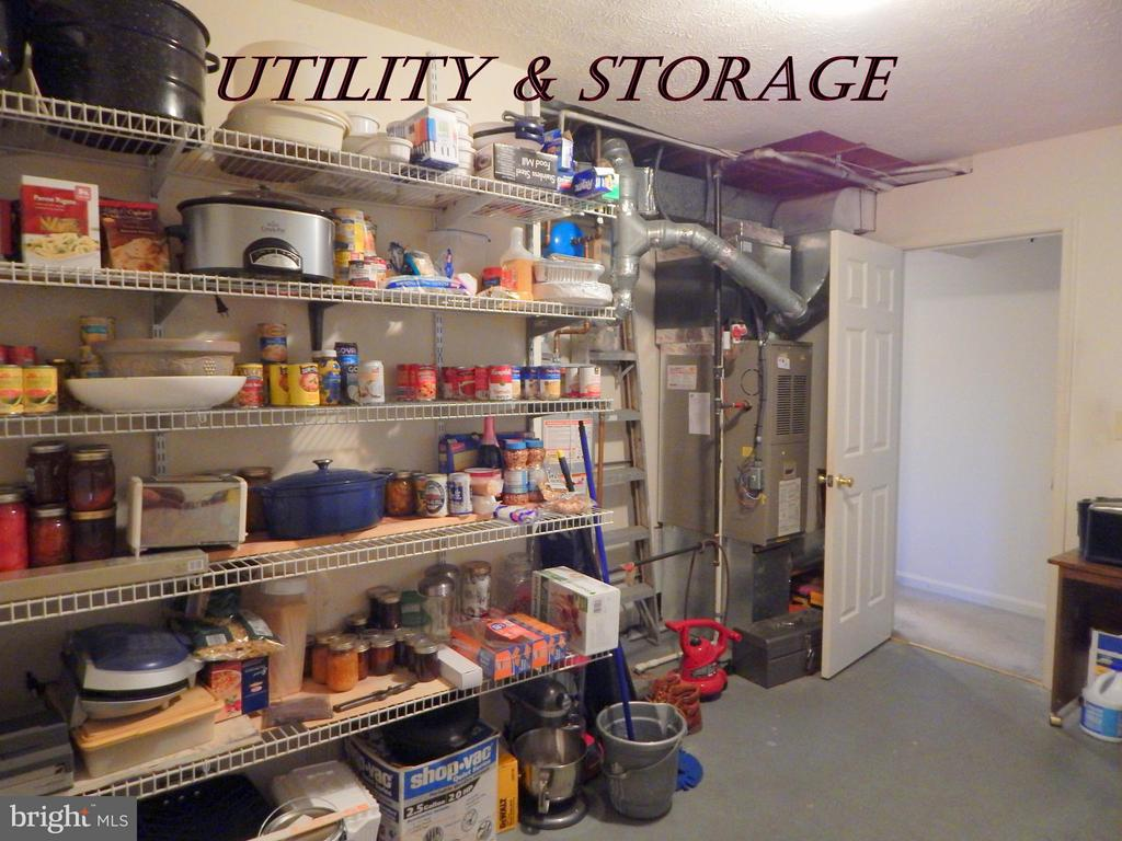 Laundry/utility rm w/storage shelving. W/D conveys - 11604 BRIAN DR, FREDERICKSBURG