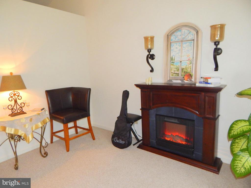 Living Room fireplace w/ wall sconces that convey. - 11604 BRIAN DR, FREDERICKSBURG
