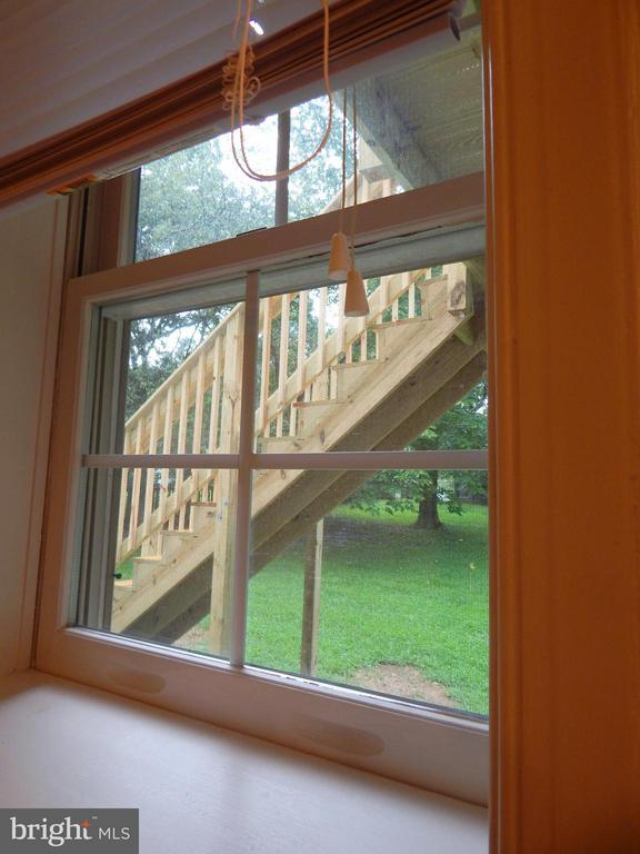 View from bsmt BA through new deck stairs to lg yd - 11604 BRIAN DR, FREDERICKSBURG