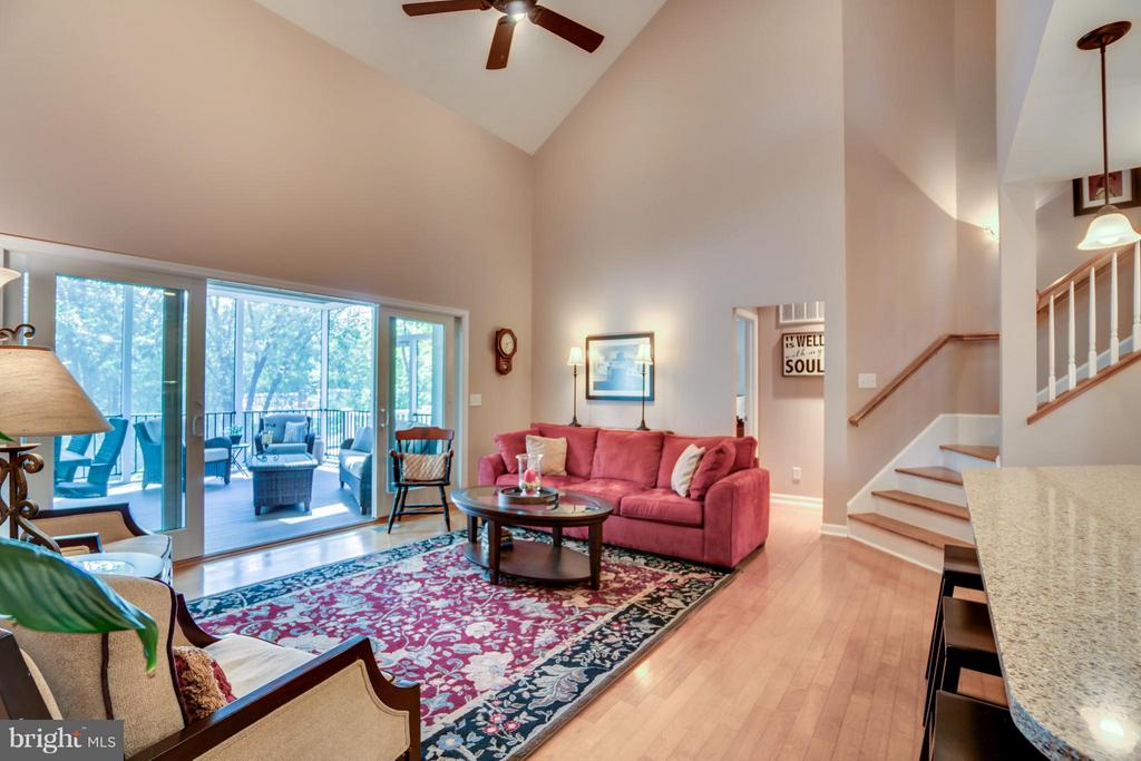 LIVING ROOM OPENS TO A BEAUTIFUL SCREENED IN PORCH - 102 HARRISON CIR, LOCUST GROVE