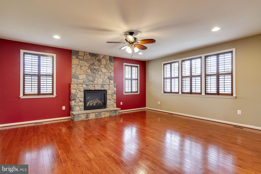 Family Room  with Full Stone Fireplace - 6012 FOX HAVEN CT, WOODBRIDGE