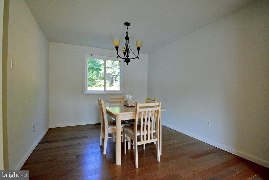Dining Room with Hardwood Floors - 7307 BONNIEMILL LN, SPRINGFIELD
